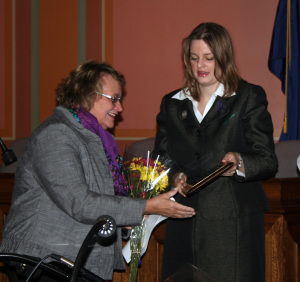 Bobbie Bohen, left, a Crisis Counselor at CAP Services' Family Crisis Center in Stevens Point, receives the Governor's Council on Domestic Abuse's Courage Award from State Representative Katrina Shankland, D-Stevens Point, during a ceremony Wednesday, Oct. 8, in Madison.