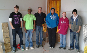 Fresh Start Site Manager Jesse Kusserow, third from left, stands with the first program participants brought in under new YouthBuild Program funding.