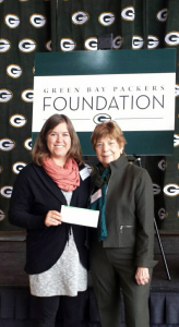 From left, Jane Benzschawel, CAP Services' Family Crisis Center (FCC) coordinator, and Marg Coker-Nelson, FCC Advisory Board member, accepted a $3,500 check from the Green Bay Packers Foundation Thursday, Dec. 4, at a luncheon in the Lambeau Field Atrium in Green Bay.