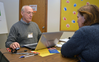 CAP Services' Volunteer Income Tax Assistance (VITA) program volunteer Paul Theyel, left, helps prepare taxes for a VITA client in Wautoma.