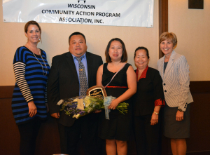 From left, Nicole Harrison, Phong Vang, Chai Moua, Pa Moua and Mary Patoka pose together at the Wisconsin Community Action Program Association's (WISCAP) Annual Meeting Wednesday, May 6, in Madison. Chai Moua, CAP's Refugee Family Strengthening Program coordinator, was recognized by WISCAP with its Exemplary Community Action Staff Member Award.