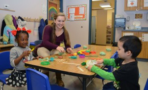Pacelli High School junior Hannah Frane (center) volunteers with Early Head Start students at CAP Services' Family Development Center in Stevens Point recently.