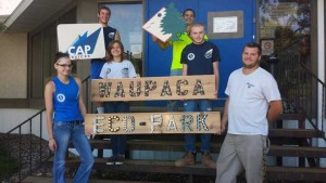 CAP Services' Fresh Start Program participants pose with the Waupaca Eco-Park sign outside the CAP Services offices in Waupaca. A public dedication celebration will be held Sept. 10 at Eco-Park, which is located on city-owned parkland adjacent to the Eastgate Estates subdivision on the city's east side.