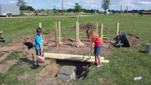 Community volunteers lay the groundwork for the natural children's playground at Waupaca's Eco-Park in early August. The completed playground will be among several park amenities on display at Eco-Park's dedication ceremony Saturday, Sept. 10.