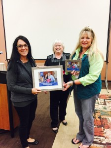 Diane Flanagan (center) Children's Health Alliance of Wisconsin's Senior Project Manager for Oral Health, presents CAP Services' Rachel Smola (left) and Deana Hirte (right) with the Alliance's Outstanding Partner Award at its recent Oral Health Conference in Stevens Point.