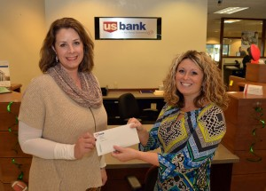Nicole Harrison, left, CAP Services' VP of Human Development, receives a grant check from Kelly Johnson, U.S. Bank Branch Manager and Small Business Specialist, Tuesday, Nov. 29, at U.S. Bank in Stevens Point. The funds will help support CAP's Skills Enhancement Program.