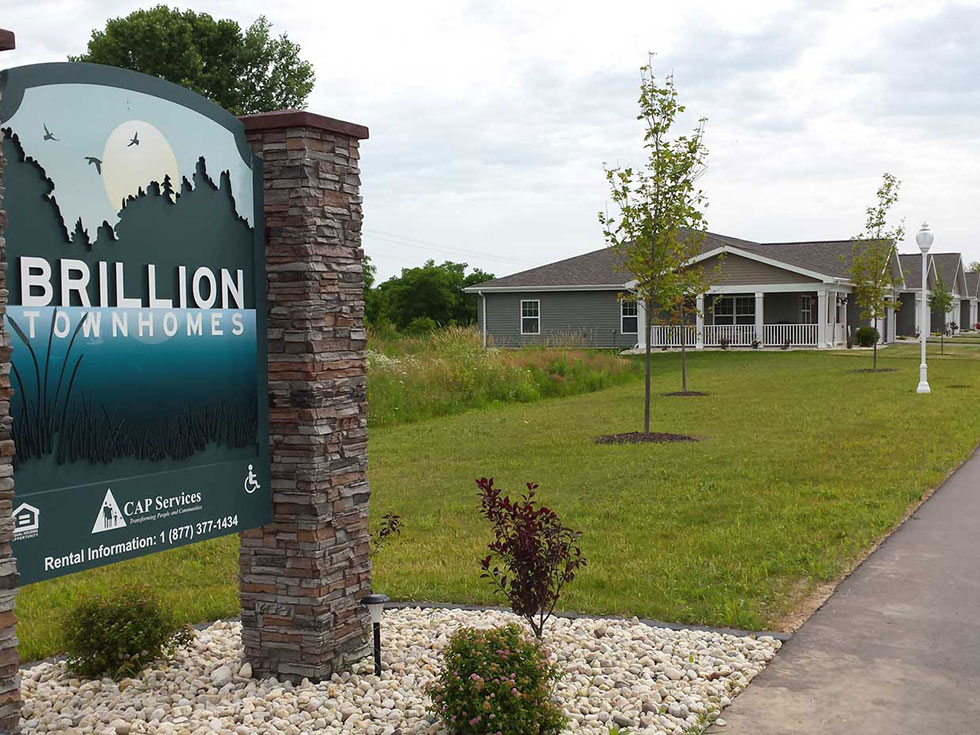 Brillion Townhomes Exterior with Sign