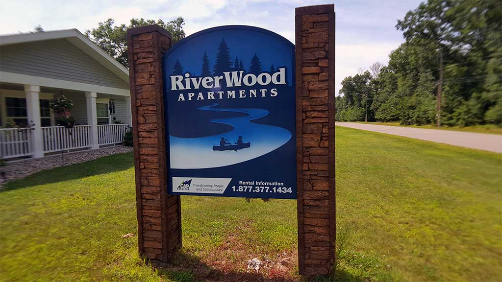 River Wood exterior with sign