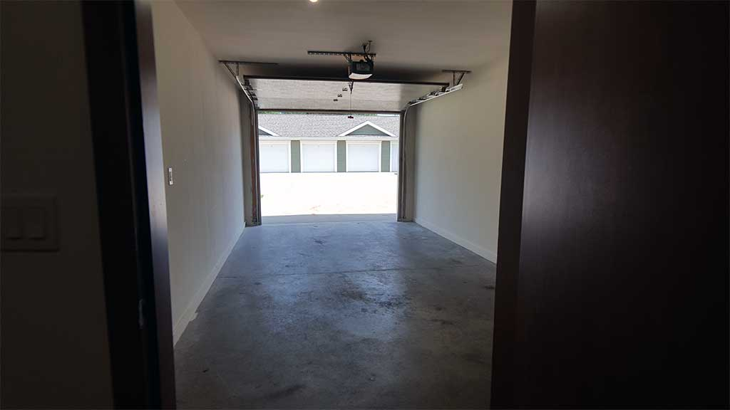 River Wood looking out open garage from inside