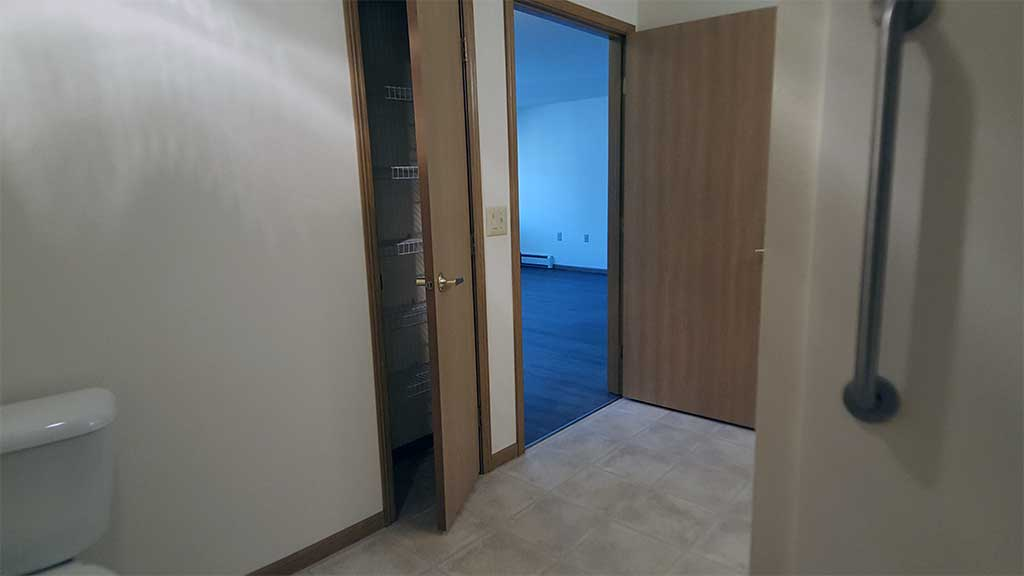 Wolf River SV full bathroom linen closet front building