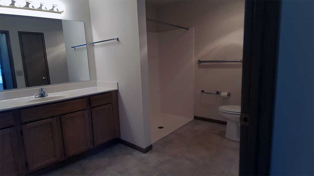 Wolf River SV full bathroom roll-in shower front building