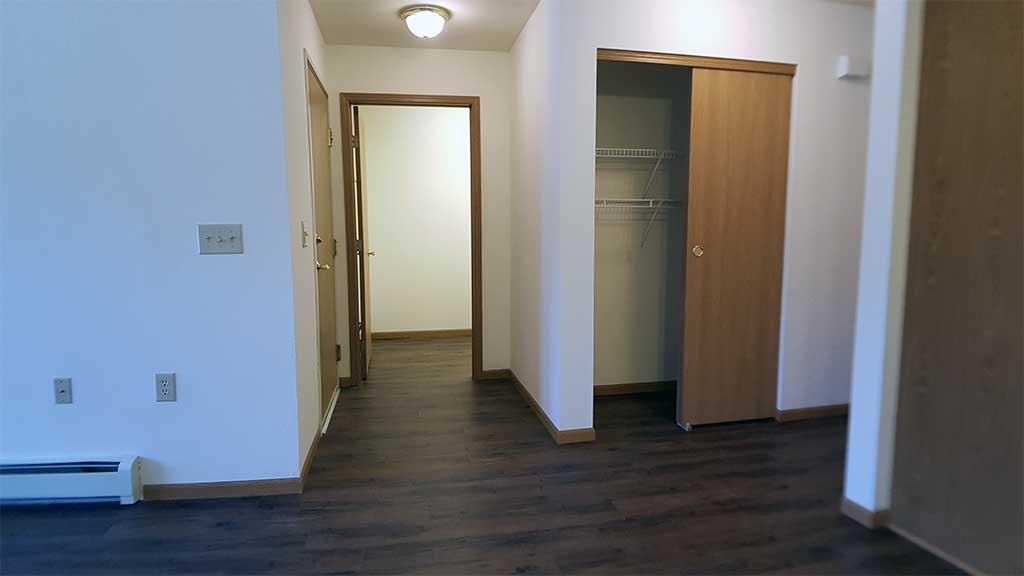Wolf River SV main hallway closet, laundry, garage entry back building