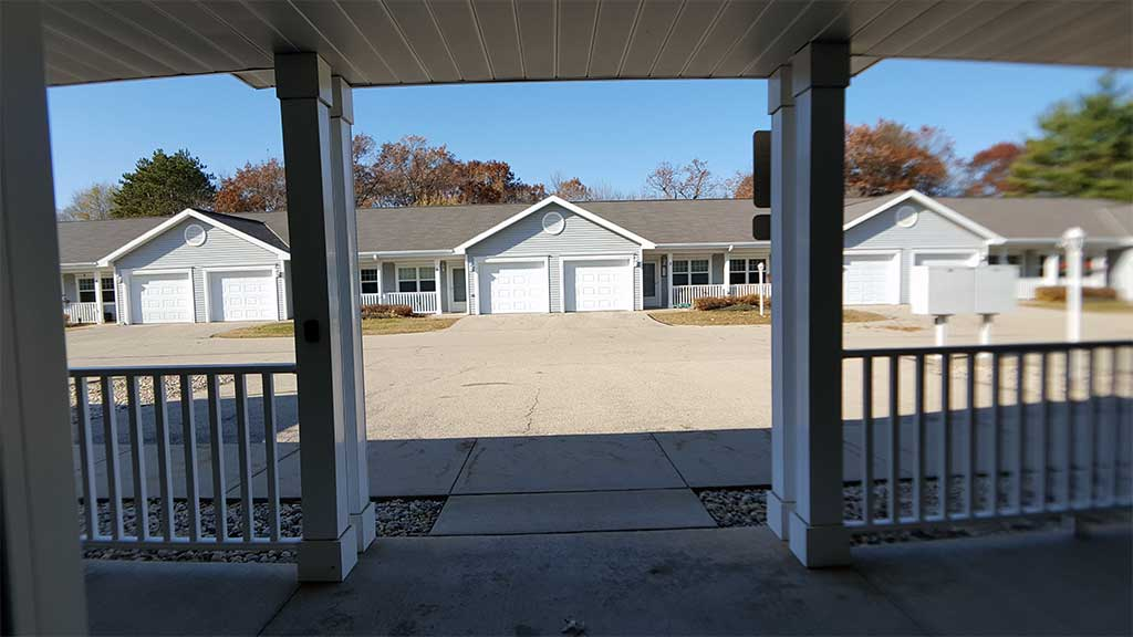 Wolf River SV clubhouse exterior view from back porch