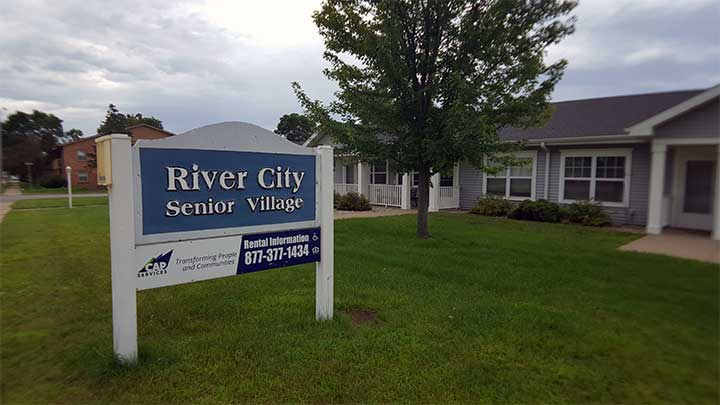 River City SV Property exterior with sign close-up